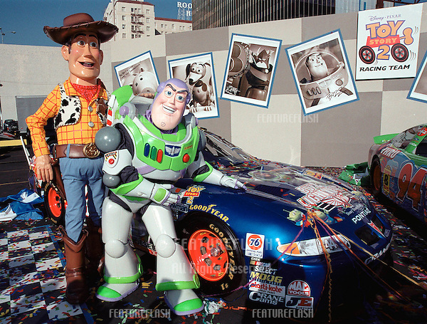 "23OCT99: ""Toy Story"" characters ""WOODY"" (left) & ""BUZZ LIGHTYEAR"" at promotion in Hollywood to unveil three NASCAR racing cars themed to ""Toy Story 2"" which opens next month.                            .© Paul Smith / Featureflash"