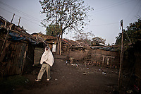 A man walks through the neighborhood of Bahir Dar where commercial sex workers wait for clients night and day, in the Northern Amhara region of Ethiopia on March 4, 2009...While in decline, early child marriage is still widely spread in rural areas of Ethiopia where families sell their daughters into marriage at ages as young as 5 years old...Names of subjects have been fictionalized and specific locations have been omitted to protect the identities of the children portrayed in the story.