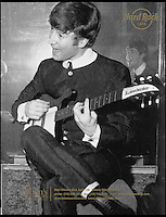 BNPS.co.uk (01202 558833)<br /> Pic: Julien's/BNPS<br /> <br /> ***Please use full byline***<br /> <br /> John Lennon trys out Harrisons new Rickenbacker in the early sixties.<br /> <br /> A guitar belonging to George Harrison that helped propel the Beatles to international stardom has emerged for sale for a whopping &pound;360,000 when it goes under the hammer at Julien's Auctions in New York on May 17.<br /> <br /> Harrison bought the 1962 Rickenbacker 425, in 1963 not long after the release of the Beatles' first single Love Me Do and played it on I Want to Hold Your Hand, the song that launched them in America.<br /> <br /> It was originally an orange colour but Harrison insisted it was refinished in black to match a similar guitar which John Lennon owned.<br /> <br /> Harrison played it in numerous shows including appearances on music programmes Ready, Steady, Go! and Thank Your Lucky Stars.<br /> <br /> In the late 1960s he modified the guitar and gifted it to his friend George Peckham, a record cutting engineer and musician whose band had supported the Beatles before they were famous.<br /> <br /> A photo of the Beatles posing with the instrument is thought to be the only one in existence featuring the band with just one guitar.