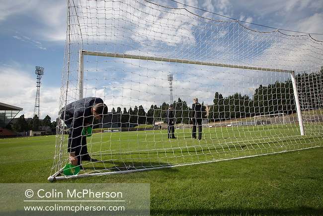 The referee and his assistants checking one of the goals prior to the SPFL2 fixture between Edinburgh City and Berwick Rangers at Meadowbank Stadium. Despite taking the lead in the 66th minute through Ousman See's goal, City lost the game 2-1, watched by a crowd of 410 and remained without a point at the foot of the table after four League games.