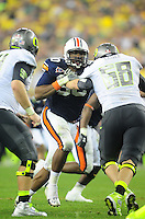 Jan 10, 2011; Glendale, AZ, USA; Auburn Tigers defensive tackle Nick Fairley (90) against the Oregon Ducks in the 2011 BCS National Championship game at University of Phoenix Stadium. Auburn defeated Oregon 22-19. Mandatory Credit: Mark J. Rebilas-