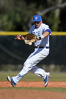 South Dakota State JackRabbits first baseman Aaron Machbitz (33) fields a ground ball during a game against the Georgetown Hoyas at South County Regional Park on March 9, 2014 in Port Charlotte, Florida.  Georgetown defeated South Dakota 7-4.  (Mike Janes/Four Seam Images)