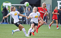 Portland, Oregon - Sunday October 2, 2016: Western New York Flash defender Jaelene Hinkle (15) and Abigail Dahlkemper (13) keep the ball away from Portland Thorns FC midfielder Lindsey Horan (7) during a semi final match of the National Women's Soccer League (NWSL) at Providence Park.