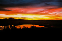 A stunning sunrise explodes over Ngorongoro Crater and Lake Magadi in Tanzania, East Africa.