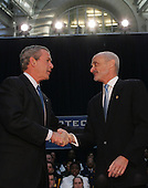 Washington, D.C. - March 3, 2005 -- United States President George W. Bush, left, and Michael Chertoff, right, shake hands before Michael Chertoff takes the oath of office as Secretary of Homeland Security at the Ronald Reagan Building in Washington, DC. on March 3, 2005.<br /> Credit: Dennis Brack - Pool via CNP