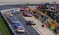 Jun 1, 2008; Dover, DE, USA; NASCAR Sprint Cup Series driver Greg Biffle (16) leads the field onto pit road during the Best Buy 400 at the Dover International Speedway. Mandatory Credit: Mark J. Rebilas-US PRESSWIRE