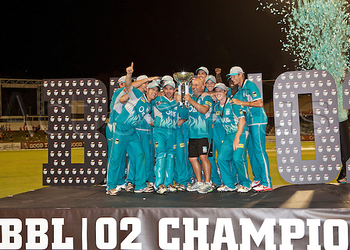 19.01.2013 Perth, Australia. Brisbane Heat players celebrate after winning the KFC T20  Big Bash Final against the Perth Scorchers at the WACA.