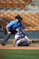 Umpire Tom Woodring and Glendale Desert Dogs Garrett Stubbs (4), of the Houston Astros organization, await the pitch during a game against the Mesa Solar Sox on October 20, 2016 at Camelback Ranch in Glendale, Arizona.  Glendale defeated Mesa 3-2.  (Mike Janes/Four Seam Images)
