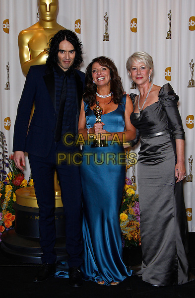 RUSSELL BRAND, SUSANNE BIER & HELEN MIRREN.BEST FOREIGN LANGUAGE FILM - IN A BETTER WORLD.83rd Annual Academy Awards - Oscars.Kodak Theatre, London, England..Hollywood, Ca.February 27th, 2011.full length black suit blue grey gray silk satin dress trophy award pressroom press room.CAP/PE.©Peter Eden/Capital Pictures.