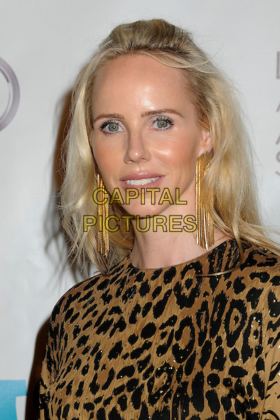 VANESSA GETTY.16th Annual Los Angeles Antiques Show Opening Night Gala Benefiting P.S. Arts held at Barker Hangar, Santa Monica, California, USA..April 13th, 2011.headshot portrait black brown leopard print dangling gold earrings.CAP/ADM/BP.©Byron Purvis/AdMedia/Capital Pictures.