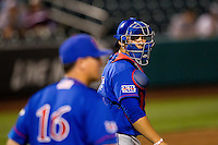 Alex DeLeon (34) of the Kansas Jayhawks walks to the mound for a conference during a game against the Missouri State Bears at Hammons Field on March 27, 2012 in Springfield, Missouri. (David Welker/Four Seam Images)