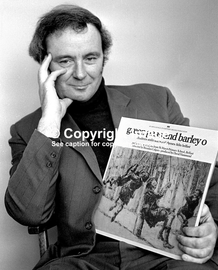 "David Hammond, writer, singer, teacher, songwriter, historian, musician, film-maker, broadcaster, Belfast, N Ireland, with one of his LPs of local street songs titled  ""green peas and barley o"". 197504000337b..Copyright Image from Victor Patterson, 54 Dorchester Park, Belfast, United Kingdom, UK...For my Terms and Conditions of Use go to http://www.victorpatterson.com/Victor_Patterson/Terms_%26_Conditions.html"