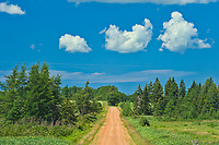 Country road, clouds and red soil<br />