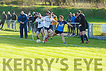 Dara Moynihan of I T Tralee under pressure from Ben McDonnell and Terrence O'Brien of the Ulster University in the 1st round of the Sigerson Cup Senior football in John Mitchells on Sunday.