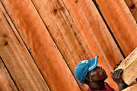 A Colombian worker stacks a timber from the rainforest at a sawmill yard in Tumaco, Colombia, 19 June 2010. Tens of sawmills located on the banks of the Pacific jungle rivers generate almost half of the Colombia's wood production. The wood species processed here (sajo, machare, roble, guabo, cargadero y pacora) are mostly used in the construction industry and the paper production. Although the Pacific lush rainforest in Colombia is one of the most biodiverse area of the world, the region suffers an extensive deforestation due to the uncontrolled logging in the last years.