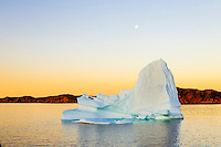 Iceberg floats in Trinity Bay off the Bonavista Peninsula of eastern Newfoundland, Newfoundland and Labrador, Canada.