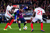 30th January 2019, Camp Nou, Barcelona, Spain; Copa del Rey football, quarter final, second leg, Barcelona versus Sevilla; Amadou of Sevilla CF pulls back Lionel Messi of FC Barcelona
