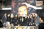 Partners and models pose at the Kollagenx booth during the 2013 International Beauty Show at the Javits Convention Center in New York City on April 15, 2013.