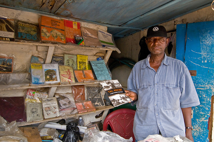 Man in his bookshop on Aberdeen Road, Freetown. Sierra Leone.