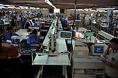 Porto Alegre, Brazil. Workers on the shop floor of the Azaleia shoe factory; Rio Grande do Sul.