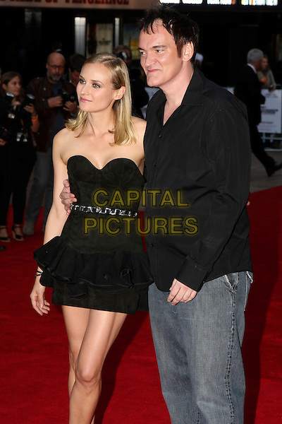 DIANE KRUGER & QUENTIN TARANTINO.UK Premiere of 'Inglourious Basterds' at the Odeon, Leicester Square, London, England. .July 23rd, 2009.half length black dress strapless chain belt jeans denim 3/4.CAP/MAR.© Martin Harris/Capital Pictures.