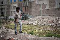 Bangladeshi Garments worker Rhedoy, 28, a victim of Rana Plaza collapse, stands at the collapse site. Rhedoy worked at 7th floor of the Rana Plaza.