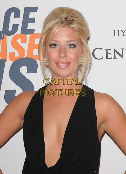 HOLLY MONTAG .at the 17th Annual Race to Erase MS held at The Hyatt Regency Century Plaza in Beverly Hills, California, USA, May 7th 2010..portrait headshot  black sleeveless low cut plunging neckline earrings make-up hair pearls .CAP/RKE/DVS.©DVS/RockinExposures/Capital Pictures.