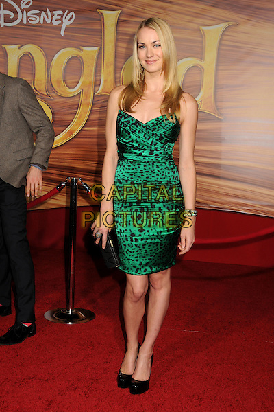"YVONNE STRAHOVSKI.""Tangled"" Los Angeles Premiere held at the El Capitan Theatre, Hollywood, California, USA..November 14th, 2010.full length leopard print dress black green strapless shoes clutch bag .CAP/ADM/BP.©Byron Purvis/AdMedia/Capital Pictures."