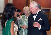 02 February 2019 - Prince Charles Prince of Wales and Camilla Duchess of Cornwall meet former cricketer Isa Guha, at the British Asian Trust Dinner at Buckingham Palace in London. This year's event will celebrate recent achievements of the British Asian Trust as well as heralding ambitious new plans to provide social impact at scale across South Asia and to acknowledge the role of key supporters. Photo Credit: ALPR/AdMedia