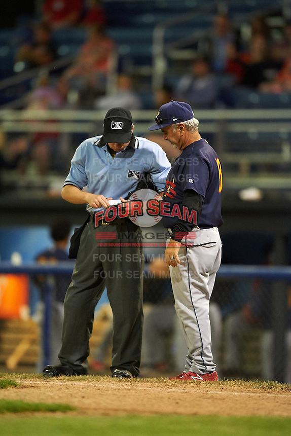 State College Spikes manager Johnny Rodriguez (18) makes a change with umpire John Budka during a game against the Batavia Muckdogs on June 24, 2016 at Dwyer Stadium in Batavia, New York.  State College defeated Batavia 10-3.  (Mike Janes/Four Seam Images)
