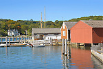 Mystic Seaport Museum and historic villege. Mystic River boats, and water front boathouses.
