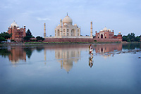 India, Agra. The challenge lay before me: how does one photograph an image as iconic as the Taj Mahal that's been photographed so many times before and make it my own? My solution was to hire a small boat to bring me across the Yamuna River to the backside every morning. Here on the river village life unfolds in the early dawn as fisherman emerge with their nets, locals perform their early morning ablutions, animals come to drink and sadhus take their holy dip, all with the exquisite Taj Mahal almost as a forgotten back-drop.