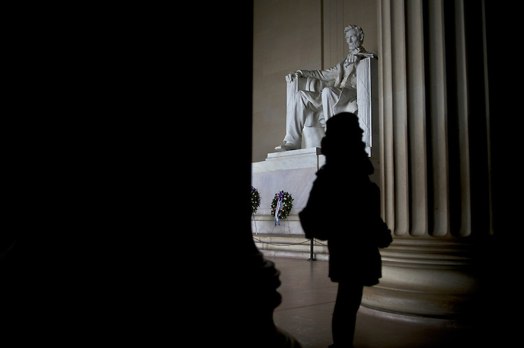 UNITED STATES - FEBRUARY 19: Tourists take in the sights of the Lincoln Memorial on a rainy day. Both houses of Congress are in recess this week after President's Day.( Photo by Chris Maddaloni/CQ Roll Call)