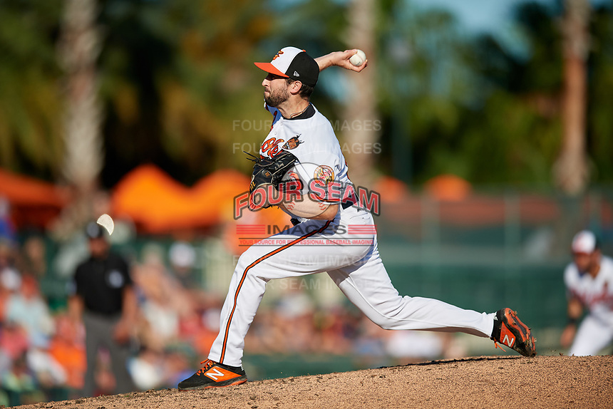 Baltimore Orioles relief pitcher Lucas Long (90) delivers a pitch during a Grapefruit League Spring Training game against the Detroit Tigers on March 3, 2019 at Ed Smith Stadium in Sarasota, Florida.  Baltimore defeated Detroit 7-5.  (Mike Janes/Four Seam Images)