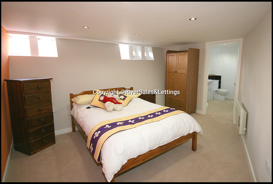 BNPS.co.uk (01202 558833)<br /> Pic: RiverSales&Lettings/BNPS<br /> <br /> ****Please use full byline****<br /> <br /> Bedroom.<br /> <br /> A 100-year-old barge once used to ship cargo up and down the River Thames has been transformed into a plush four-bedroom house that is now on the market for £450,000.<br /> <br /> The 90ft boat was salvaged from the banks of Thames in the 1970s and turned into a floating dormitory for schoolchildren at an outdoor activity centre.<br /> <br /> But it has since been given a complete makeover and now looks more like a cosy country cottage than a boat.<br /> <br /> The two-storey houseboat runs off mains electricity, has wifi access, electric heating, and hot water, and it also has a reserve water tank stored in its funnel.<br /> <br /> And buyers can count the picturesque River Hamble near Southampton, Hants, as their back garden.