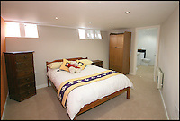 BNPS.co.uk (01202 558833)<br /> Pic: RiverSales&amp;Lettings/BNPS<br /> <br /> ****Please use full byline****<br /> <br /> Bedroom.<br /> <br /> A 100-year-old barge once used to ship cargo up and down the River Thames has been transformed into a plush four-bedroom house that is now on the market for &pound;450,000.<br /> <br /> The 90ft boat was salvaged from the banks of Thames in the 1970s and turned into a floating dormitory for schoolchildren at an outdoor activity centre.<br /> <br /> But it has since been given a complete makeover and now looks more like a cosy country cottage than a boat.<br /> <br /> The two-storey houseboat runs off mains electricity, has wifi access, electric heating, and hot water, and it also has a reserve water tank stored in its funnel.<br /> <br /> And buyers can count the picturesque River Hamble near Southampton, Hants, as their back garden.