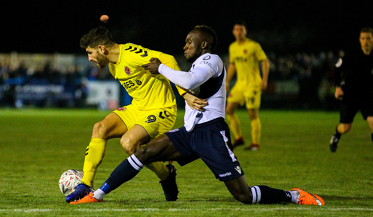Fleetwood Town's Ched Evans shields the ball from Guiseley's Cliff Moyo<br /> <br /> Photographer Alex Dodd/CameraSport<br /> <br /> The Emirates FA Cup Second Round - Guiseley v Fleetwood Town - Monday 3rd December 2018 - Nethermoor Park - Guiseley<br />  <br /> World Copyright &copy; 2018 CameraSport. All rights reserved. 43 Linden Ave. Countesthorpe. Leicester. England. LE8 5PG - Tel: +44 (0) 116 277 4147 - admin@camerasport.com - www.camerasport.com