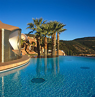 The curved infinity pool echoes the bubble-shape of the Palais Bulles situated overlooking the Cote d'Azur