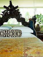 Close up of a Portuguese 18th century bed with a hand-crafted wool cover