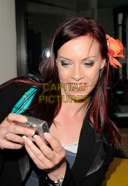 "SHARON MARSHALL.""This Morning"" aftershow party at LWT Studios, South Bank, London, England 17th July 2009.half length orange flower in hair camera taking picture photograph black jacket .CAP/CAN.©Can Nguyen/Capital Pictures"