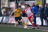 Mark Byrne of Newport County and Matty Pearson of Accrington Stanley during the Sky Bet League 2 match between Newport County and Accrington Stanley at Rodney Parade, Newport, Wales on 28 March 2016. Photo by Mark  Hawkins.