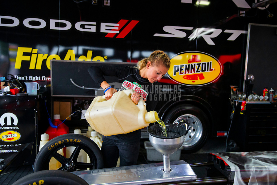 May 5, 2018; Commerce, GA, USA; NHRA top fuel driver Leah Pritchett pours nitro methane race fuel into the gas tank of her dragster in the pits during qualifying for the Southern Nationals at Atlanta Dragway. Mandatory Credit: Mark J. Rebilas-USA TODAY Sports