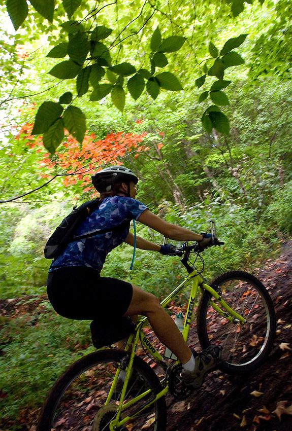 A mountain biker cruises a trail on Grand Island National Recreation Area in Munising Michigan.