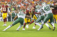 Landover, MD - August 16, 2018: Washington Redskins running back Rob Kelley (20) is tackled by New York Jets defensive back Trumaine Johnson (22) during the preseason game between New York Jets and Washington Redskins at FedEx Field in Landover, MD.   (Photo by Elliott Brown/Media Images International)