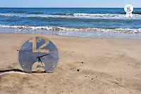 Clock on beach by sea (Licence this image exclusively with Getty: http://www.gettyimages.com/detail/83154260 )