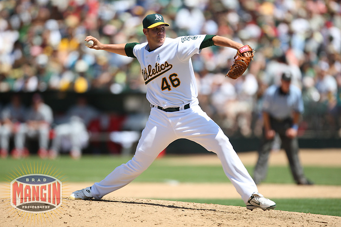 OAKLAND, CA - June 17:  Colby Lewis of the Oakland Athletics pitches during the game against the St. Louis Cardinals at the McAfee Coliseum in Oakland, California on June 17, 2007.  The Cardinals defeated the Athletics 10-6.  Photo by Brad Mangin