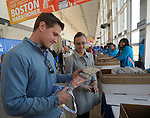 (Boston Ma 042014) Stephen Engel, 26, with girl friend Jennifer Bruhns, 22, both of South Windsor CT., as Engels looks over his bib number he just was handed, at the Hynes Center in Boston, Sunday, April 20, 2014, the day before the Boston Marathon. (Jim Michaud Photo) For Sunday