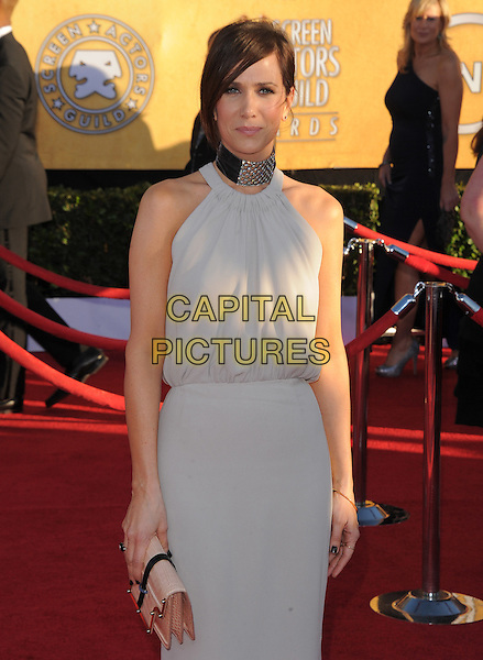 Kristen Wiig.18th Annual Screen Actors Guild Awards held at The Shrine Auditorium, Los Angeles, California, USA..January 29th, 2012.SAG SAGS half length white sleeveless dress grey gray pink clutch bag.CAP/RKE/DVS.©DVS/RockinExposures/Capital Pictures.