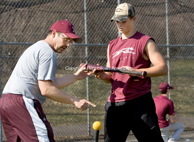 NAUGATUCK, CT. 19 March 2012-031912SV08-From left, Coach Tom Deller gives Zac Mercer, 18, of Naugatuck some pointers during the first day of tryouts at Naugatuck High School in Naugatuck Monday..Steven Valenti Republican-American