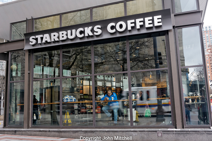 Exterior of a Starbucks Coffee shop in downtown Seattle, Washington, USA